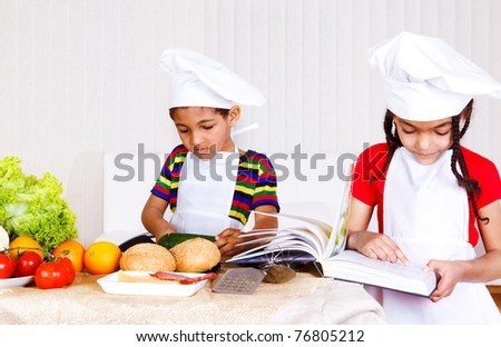 African american brother and sister cooking - stock photo
