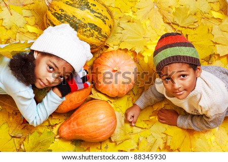 African american brother and sister with autumnal harvest