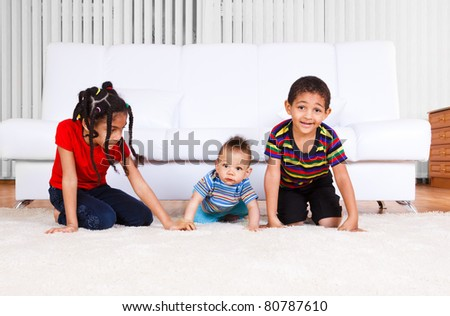 African american brothers and a sister crawling - stock photo
