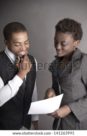 African American business man and his secratary discuss a contract - stock photo