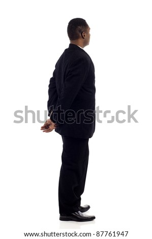African American business man from the back looking at something isolated white background - stock photo