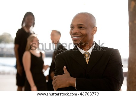 African American business man in front of business team - stock photo