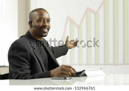 African American business man presenting profits - stock photo