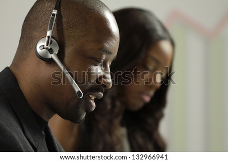 African American business man taking a sales call - stock photo