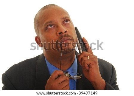 African American business man talking on phone thinking, isolated on white. - stock photo