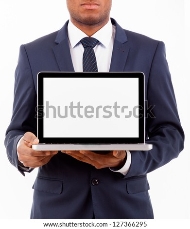 African American business man with a laptop computer isolated over a white background - stock photo