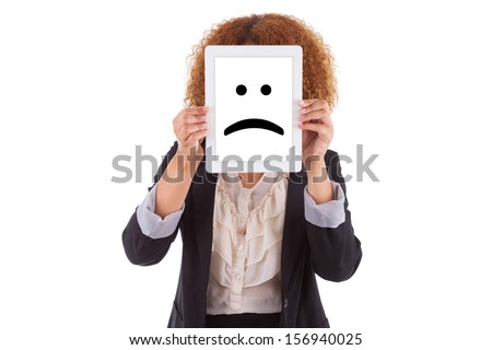 African American business woman holding a tactile tablet displaying a sad emoticon, isolated on white background - Black people - stock photo