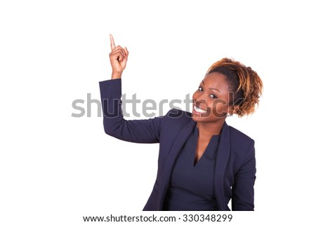 African American business woman pointing something up - stock photo