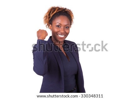 African American business woman with clenched fist - stock photo
