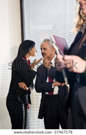 African American businessman and female colleague in private discussion - stock photo