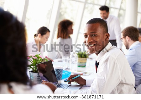 African American Businessman At Meeting With Colleagues - stock photo