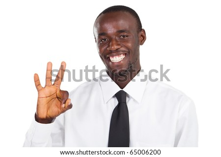african american businessman giving ok hand sign - stock photo