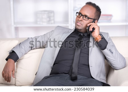 African-american businessman is talking on a phone. - stock photo