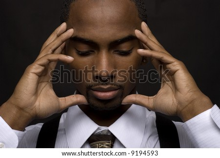 African American businessman is thinking intensely - stock photo