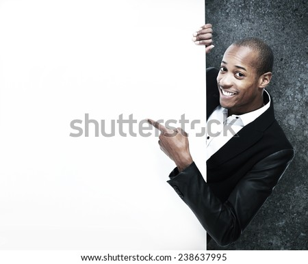 African-American Businessman near black wall background - stock photo