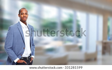 African-american businessman ove modern office background. - stock photo