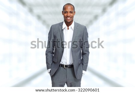African-American Businessman over office background - stock photo