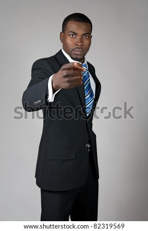 African American businessman pointing finger at you.