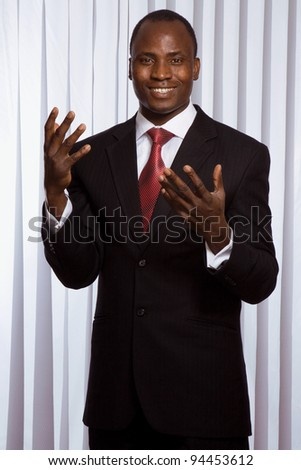 African american businessman standing in office - stock photo