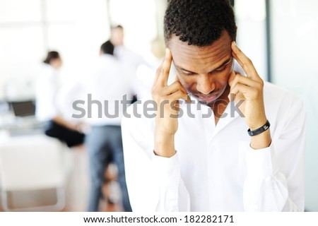African American businessman stressed in office - stock photo