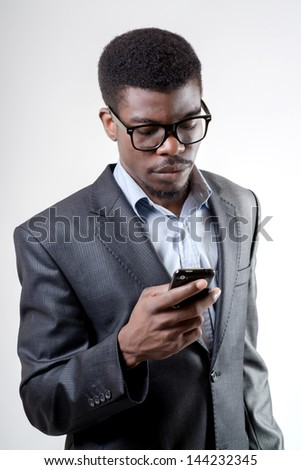 African-American businessman using smartphone - stock photo