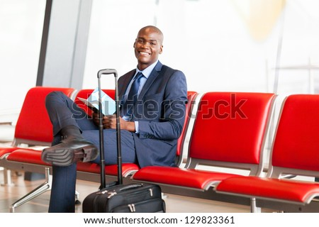 african american businessman waiting flight in airport - stock photo