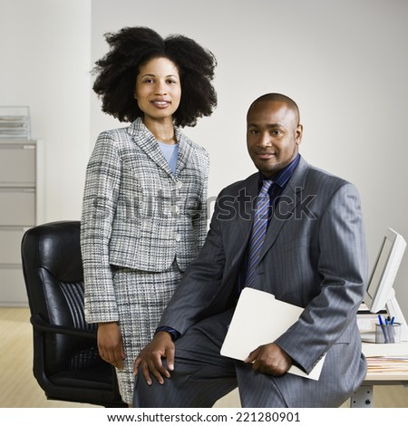 African American businesspeople in front of desk - stock photo