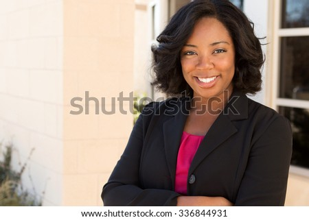African American businesswoman at work. - stock photo