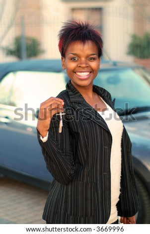 African American businesswoman happy with keys to new car - stock photo