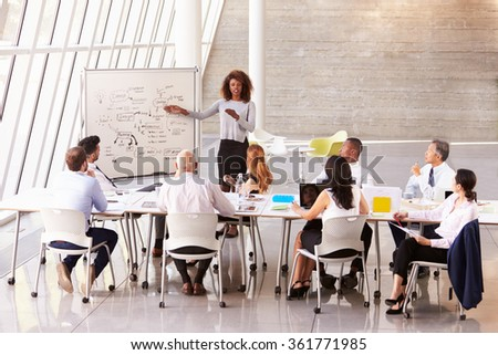 African American Businesswoman Leads Boardroom Meeting - stock photo