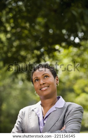 African American businesswoman looking up - stock photo