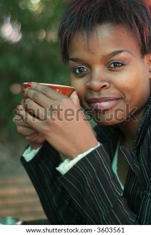 African American businesswoman portrait with coffee - stock photo