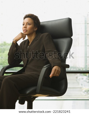 African American businesswoman sitting in chair - stock photo