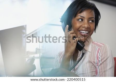 African American businesswoman talking on telephone - stock photo