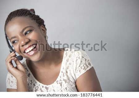African American Call Centre Agent talking to a client - stock photo