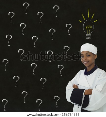 African American Chef with chalk question ideas on blackboard background - stock photo