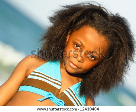 African American child at the beach - stock photo