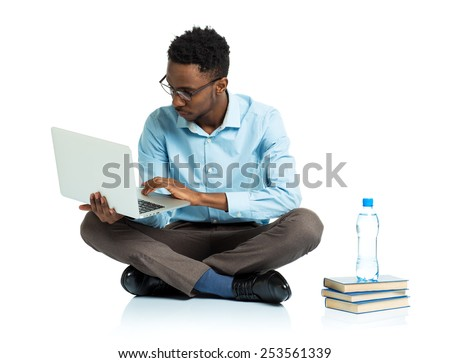 African american college student sitting with laptop on white background - stock photo