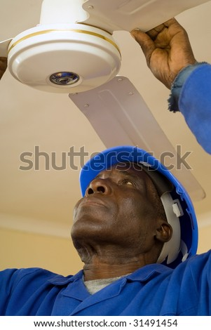 African American Construction Worker, Handyman, Carpenter, Electrician, Fixing Ceiling Fan