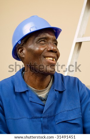 African American Construction Worker, Handyman, Carpenter, Resting on Ladder Steps