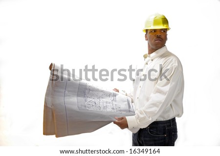 African American Contractor checking house plans - stock photo