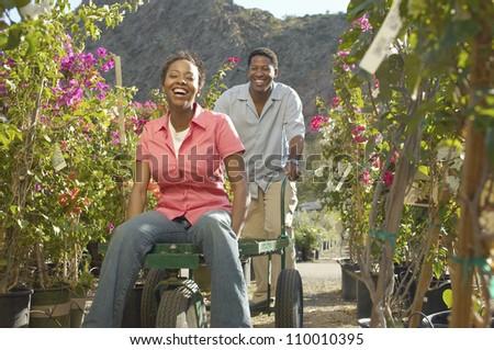 African American Couple Enjoying in a Botanical Garden - stock photo