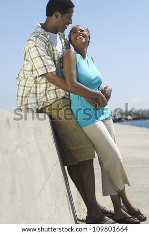 African American couple enjoying themselves at beach