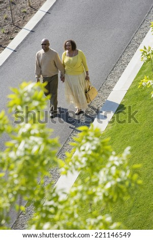 African American couple holding hands - stock photo