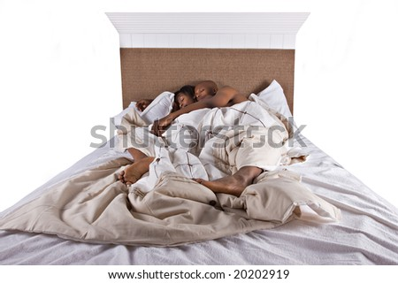 african american couple in bed sleeping - stock photo