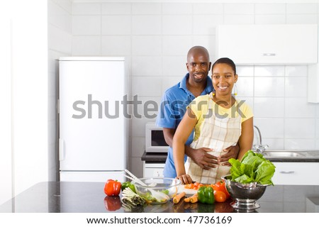 african american couple in kitchen - stock photo