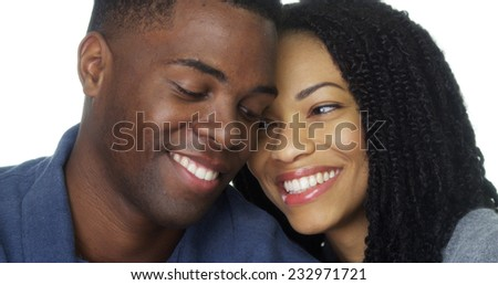 African American couple in love smiling and looking at camera - stock photo
