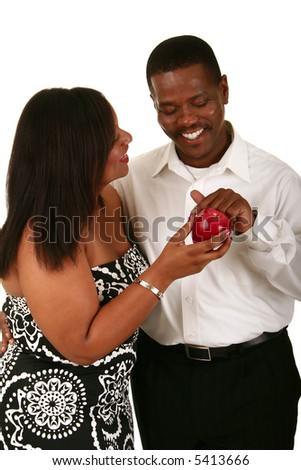 african american couple posing as adam and eve. adam touching the apple from eve