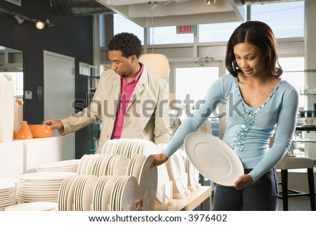 African American couple shopping in a home furnishings retail store. - stock photo