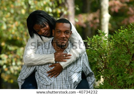African-American couple together outside on a fall day bonding - stock photo